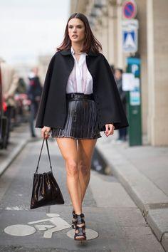Alessandra Ambrosio wearing  Azzedine Alaia Felted Wool Babydoll Cape Coat, Azzedine Alaia Laser-cut leather bucket bag, Azzedine Alaia Whipstitched python sandals, Azzedine Alaia Fringed Suede Belt