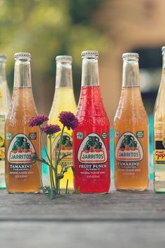 Add a pop of color to any drink table with Jarritos. http://www.weddingchicks.com/2013/10/31/dia-de-los-muertos/