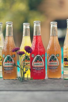 Add a pop of color to any drink table with Jarritos. http://www.weddingchicks.com/2013/10/31/dia-de-los-muertos/