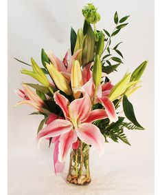 These beautiful hand selected fresh cut enchantment lilies, native to Japan and China, and cultivated today in Holland and California, are so simple, yet so elegant -- designed using only the flowers and a touch of complimenting greenery. Just beautiful! Beach Flowers, Spring Flowers, Get Well Flowers, Same Day Flower Delivery, Spring Has Sprung, Rose Bouquet, Stargazing, Beautiful Hands, Floral Arrangements