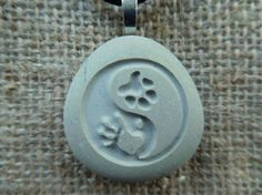 Hand Paw Yin yang engraved pendant necklace by SeaStoneFrog