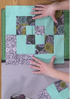 Simple Quilt Blocks: Bento Box -- The bento box quilt block starts out the same as a courthouse steps block. On this episode of My First Quilt, Sara Gallegos talks about how to choose where to put prints and solids within that starting courthouse steps block for good contrast, then demonstrates how to cut those blocks in half and rejoin them to create bento box blocks.
