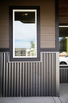 Give your home's exterior a unique, multi-textured appearance with corrugated metal wainscoting. Metal Shop Building, Building A House, Building Ideas, Building Plans, Morton Building Homes, Building Systems, Metal Siding, Metal Cladding, Remodeling Mobile Homes