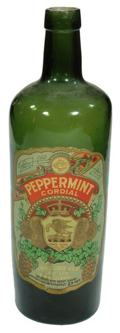 Plain green cylindrical bottle. Original label from Chas. Cole & Co., Geelong. Peppermint Cordial. Heron & Fish trade mark. c1910s