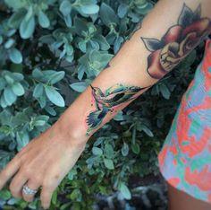 Hummingbird tattoo on wrist by Jean Alvarez