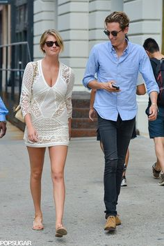 Kate Upton in NYC wearing a white lace mini dress and flat sandals