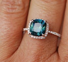 Engagement ring by Eidelprecious. Rose gold engagement ring with Green Blue sapphire. This ring features a 5ct cushion cut sapphire. The stone is clean and beautiful. It is a natural non-treated unheated stone, very rare. The color is deep peacock green blue. Super sparkling! Very