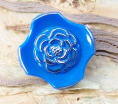 Vintage Glass button. Blue glass  Unusual Geometric shape with flower Centre. Art Deco. 1930s Blue and Silver rose button