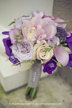 Hand Tied Wedding Bouquet Comprised Of: Dusty Pink/Lavender Cymbidium Orchids, Lavender Calla Lilies, Lavender Roses, Champagne Roses, Purple Lisianthus, Additional Coordinating Florals ~~