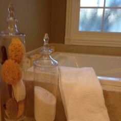 A little fluffing up at my house. Glass jars from Hobby Lobby filled with bath salts and tub toys. Spa- ish.