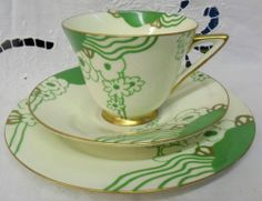 Doulton deco: Glamis tea trio, V1312, c1935 (8). Green colourway - abstract floral design in green with gold gilt highlights and trim. On my wishlist!