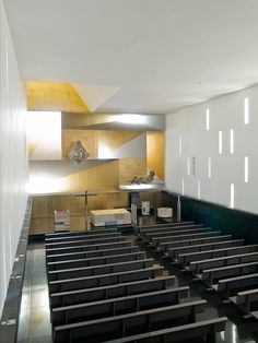 Parish Church of Santa Monica. The space feels spacious and light even without a great deal of natural light entering the building.