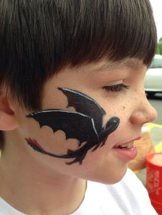 Toothless!  Face painting requested by this boy...he didn't think I could do it!    www.bunnymurals.com