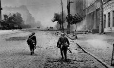 """Infantry of the Slovak """"Fast Division"""" is moving along the street in Rostov-on-Don, august 1942 - pin by Paolo Marzioli Rostov On Don, Germany Ww2, World War Two, Wwii, Two By Two, Battle, Military, Black And White, History"""