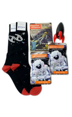 Space-Themed Sock Set Soxfords Zero G Gift Box (includes two pairs of socks, two packs of astronaut ice cream, a black Playsam rocket and vintage mags), $95, at soxfords.com