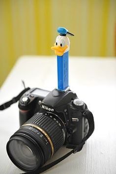 Pez dispensers.  This is an excellent way to keep little ones focused on the cameraIf your trim off their little feet they slide right into your camera flash hub.  More kid photo tips on site.