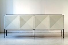 Antoine Philippon and Jacqueline Lecoq. France. 'Pointe de Diamant' Credenza, 1307 Series, 1962 White lacquered doors, palissander, chrome base 94.5 x 20.5 x 37.4 H inches 240 x 52 x 95 H cm Edition Erwin Behr, GDR 1962