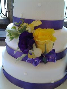Purple and yellow cake corsage