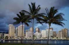 USA, Hawaii, USA, Hawaii, Oahu, Evening View of City From Magic Island (Blue); Waikiki Poster Print (17 x 11)
