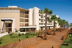 Dreams Riviera Cancun - A wooden walkway leading directly to the beach and swimming pools.