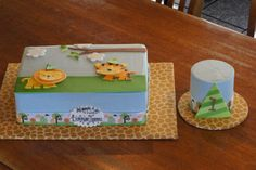 Blue safari animal themed birthday sheet cake with matching smash cake