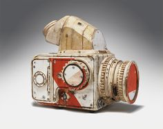Hasselblad by Tom Sachs (2008,  pyrography, thermal adhesive, ConEd barrier wood,  12.5 x 7.5 x 13 in.)