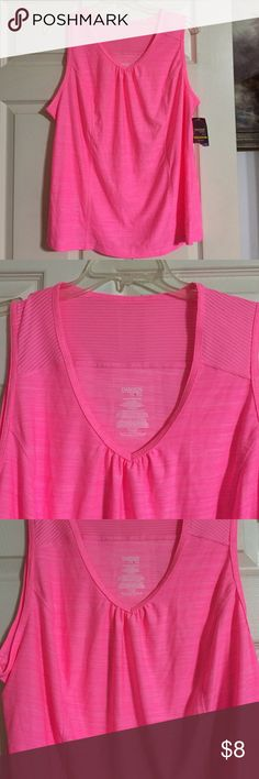 New Plus Size Danskin Athletic Active Wear Top Hot pink and really pretty. I bought this and never wore it. The tag is still attached. It is super light! 18W 20W fitted, moisture wicking fabric. Wear with black yoga pants and you are set for a workout. The bust measures 48 inches relaxed to 56 inches. Waist 46 inches to 54 inches. Hip 56 inches to 60 inches. 27 inches long shoulder to hem. Deep v cut neckline. Danskin Tops Tank Tops