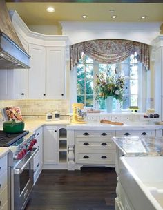 Valance - kitchen. Note arched window cornice/moulding which creates a pretty setting for a standard window treatment.  Also kitchen has no crown moulding, instead the cabinet tops are finished.