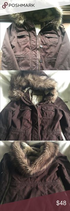 Abercrombie Faux fur WINTER coat size small Abercrombie size small winter coat. Super heavy. Lined inside with faux fur. Dark brown. The hood is not detachable. This is a super warm coat. And very heavy. Abercrombie & Fitch Jackets & Coats Utility Jackets
