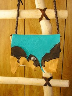 Deerskin and Cowhide Layered Leather purse in by EnchantedLeather, $50.00...this is really cool!