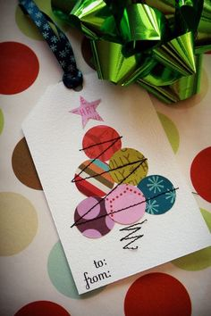 This is a gift tag, but it could easily be adapted for a card.  I see using either paper or fabric circles.