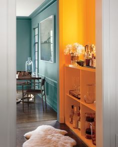 """""""Because this is a transitional space, connecting the living room with the den, Bestor used it as a visual guide: The intense color peeking out from around a door frame leads the eye into the next room. Yellow Cabinets, Teal Walls, Paint Walls, Transitional House, Interior Decorating, Interior Design, California Homes, Colorful Interiors, Home Projects"""