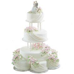 Floral Wedding Cakes While the top tiers seem to float far above the bottom stacked cakes, elegant folds of fondant and lush floral sprays pull every level together. Wedding Cake Fresh Flowers, Floral Wedding Cakes, Elegant Wedding Cakes, Cool Wedding Cakes, Elegant Cakes, Beautiful Wedding Cakes, Wedding Cake Toppers, Beautiful Cakes, Lace Wedding