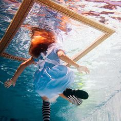 By Elena Kalis  Great concept, mirror is placed on the surface with subject below the water creating this illusion.