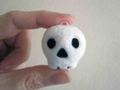 Needlefelted skull bag charm by stupidcats. 2010-2012