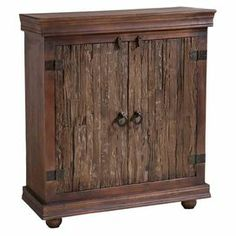 """Hand-painted cabinet with 2 doors and textured facings.  Product: CabinetConstruction Material: Solid hardwoodsColor: BrownFeatures: Hand-paintedDimensions: 36"""" H x 36"""" W x 18"""" D"""