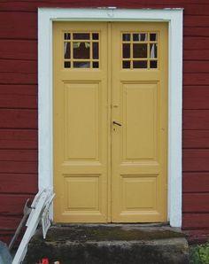 Beautiful old yellow front door.