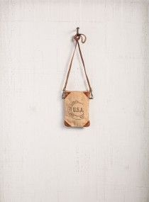 MONA B USA Stamped Crossbody - Material : Up-cycled truck tarps & military tents + canvas Trim : Genuine leather, antique metal hardware