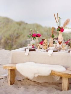 beautiful table setting on the beach for a romantic date