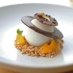 Tasty dessert by our Cercle V member Pete Schmutte made of Valrhona JIVARA 40% Anise Mousse, Apple Compote, Bourbon Sabayon, Spiced Oranges & Pumpkin-Almond Crunch!