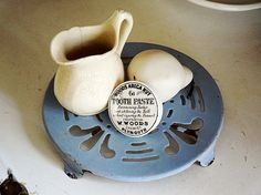 vintage French enamel trivet, round shape in a gorgeous soft lavender blue color. Available at AtticAntics, $38.00