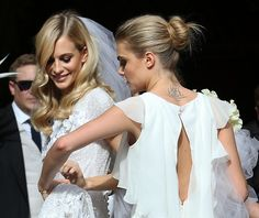 Cara and Poppy Delevingne at St. Paul Church for Poppy's wedding, May 16th, 2014.