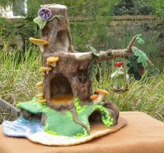 Felted Fairy House  http://livingfelt.wordpress.com/2012/06/09/a-felted-fairy-house-and-its-adorable-inhabitants/