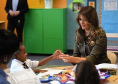 """First lady Melania Trump shares crayons with a student as she visits a youth center at Joint Base Andrewsin Maryland on Sept. 15, 2017. WATSON/AFP/Getty Images  Melania Trump loved reading Dr. Seuss's """"Oh, the Places You'll Go!"""" with her son, Barron, when he was growing up. The first lady,... - #Boo, #Dr, #Gift, #Librarian, #Melania, #News, #Rejects, #Seuss, #Trumps"""