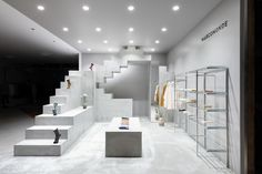 The minimalist aesthetic creates intrigue, attracting shoppers. Contemporary Japanese footwear brand Marcomonde just landed its first retail space in fashion-forward Shibuya's PARCO luxury department store. Working with just under 215 square feet on the fourth floor of the building, Canadian architecture and design firm UUfie conceived the space to be centered around a free-standing, abstract, geometric sculpture. #InteriorDesign #RetailSpaces #Japan