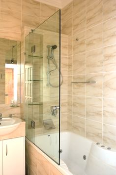 Many Queenslander bathrooms still have the shower over bath, this is a great space saver and also ideal for young families. www.euroglass.com.au