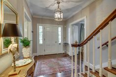 The gorgeous original hardwood floors welcome you as you enter this beautiful home.
