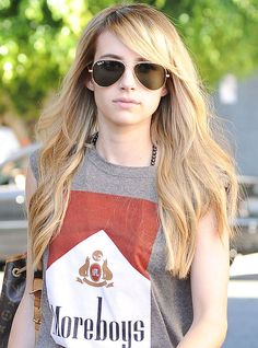 Emma Roberts with a side-fringe and blonde hair extensions