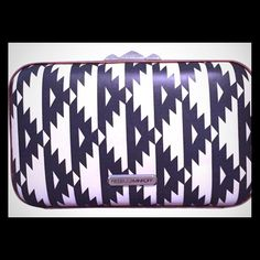 Rebecca Minkoff B&W Aztec Authentic Rebecca Minkoff product made of high quality, genuine leather. Detachable chain and dust bag included. Never been used- Excellent Conditon. Rebecca Minkoff Bags Clutches & Wristlets