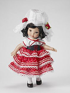 2009 Effanbee Spanish Senorita 10 inch Babette Petite Filles doll head sculpt by Tonner on a 10 inch bending knee hard plastic Ann Estelle body with inset brown stationary acrylic eyes and wigged brunette hair. Her flamenco-inspired costume includes a white with red and white cotton and dotted swiss dress with white lace trim and black corset with red ties; includes lace-trimmed and red floral applique head wear, white tights and black shoes.  Limited edition of 500. New, mint-in-the-box ... Doll Head, Doll Face, White Lace, Red And White, White Cotton, Spanish Costume, Effanbee Dolls, White Tights, Black Corset